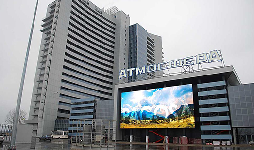 Advertising on street screens, monitors on walls and roofs